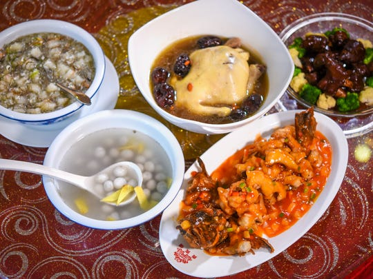 Traditional Chinese food prepared at the V.I.P. House Chinese Seafood Restaurant in Tumon on Friday, Jan. 20, 2017. One may find these tasty dishes on the table when celebrating the Chinese New Year and the Year of the Rooster. Clockwise from top left, fa chuai hao shi or seaweed with oyster soup, ji xiang ru yi, or steamed whole chicken, zhao cai jing bao or roasted pork knuckles, nian nian you yu or fried lapu-lapu (grouper) fish and the tuang tuang yuang yuang or sweet dumpling dessert soup.