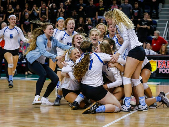 Members of the Dike-New Hartford volleyball team celebrate