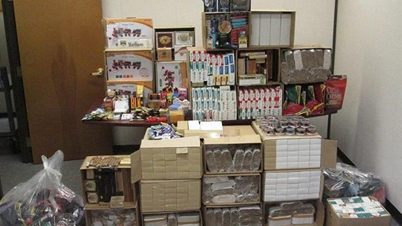 Officials allegedly seized this collection of untaxed tobacco products at Towne Centre Tobacco in Brewster.
