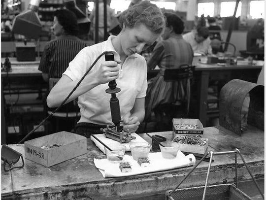 A worker inside the Hammarlund Radio plant in Mars