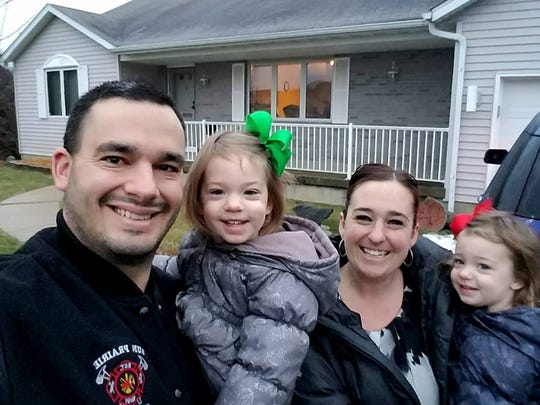 Sun Prairie firefighter Cory Barr smiles with his family
