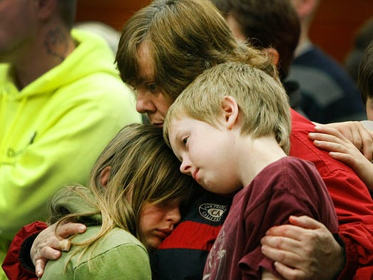 Members of the community attend a candlelight vigil at the Darrington Community Center on April 5, 2014, in Darrington, Wash. Recovery and cleanup and prayer continues after a mudslide hit Oso and killed at least 30 people.
