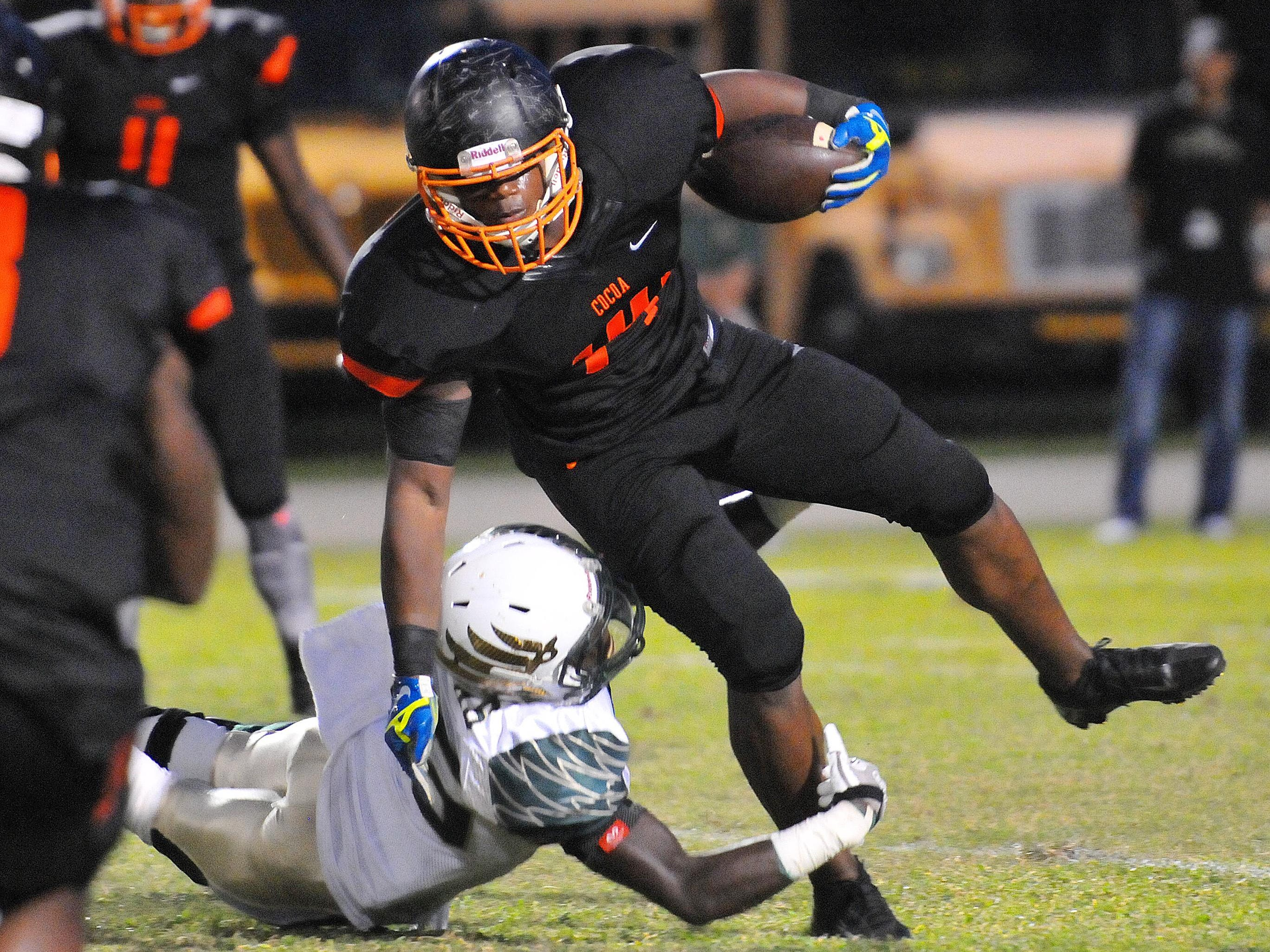 Cocoa High's Howard Stewart trys to pick up extra yards as Viera High's Jamyson Boyd holds on during Friday night's game at Tiger Stadium.