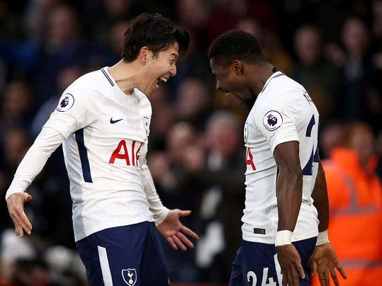 Tottenham Hotspur's Serge Aurier, right, celebrates scoring his side's fourth goal against AFC Bournemouth with teammate Son Heung-Min, during their English Premier League soccer match at the Vitality Stadium in Bournemouth, Sunday March 11, 2018. (John Walton/PA via AP)