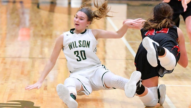 Wilson Memorial's Korinne Baska goes down in a battle for the ball during the Shenandoah District girls basketball championship in Fishersville on Thursday, Feb. 15, 2018.