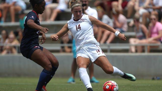 FSU's Natalia Kuikka passes the ball past South Alabama's Briana Morris  at the Seminole Soccer Complex on Sunday, Aug. 20, 2017.