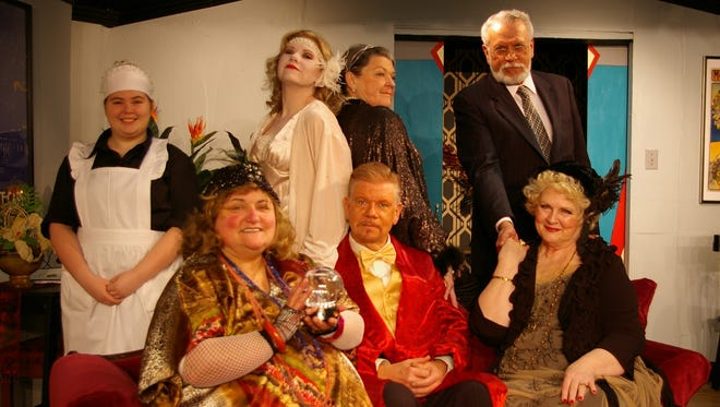 """""""Blithe Spirit"""" a comedy by Noel Coward performed by Twin Lakes Playhouse, opens this weekend. Shown are Karen McKaig as Madam Arcati, front from left; Stacy Tiffin as Charles; Deb Smith as Violet Back. Back, Aubriana Chambers as Edith;  F.E. Quiles as Elvira; Cindy Young as Ruth; Jerome Sexton as Dr. Bradman."""