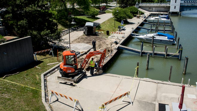 Contractors work on repairing a section of failing seawall Tuesday, June 14, 2016 along the Black River near Seventh Street in Port Huron. The section of seawall is expected to be repaired the end of the month.