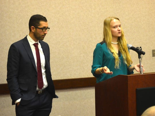 Emily Kollaritsch stands alongside her lawyer, Alex