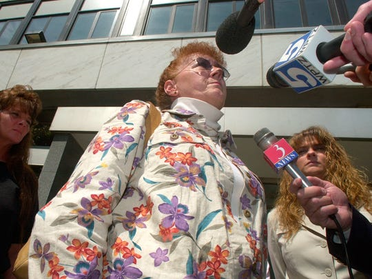 2006: Center, Barbara Tuttle, sister of murder victim Terry King, speaks to reporters outside Federal Court on Elmwood Avenue in Burlington following King's killer, Donald Fell, being sentenced to death. King's daughters Lori Hibbard, left, and Karen Worcester, right, echoed the family's satisfaction with the sentence.