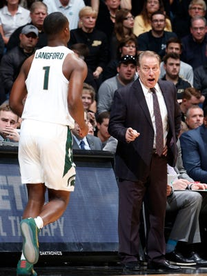 Michigan State coach Tom Izzo talks to guard Joshua Langford (1) during MSU's 80-63 loss Saturday in West Lafayette, Ind.