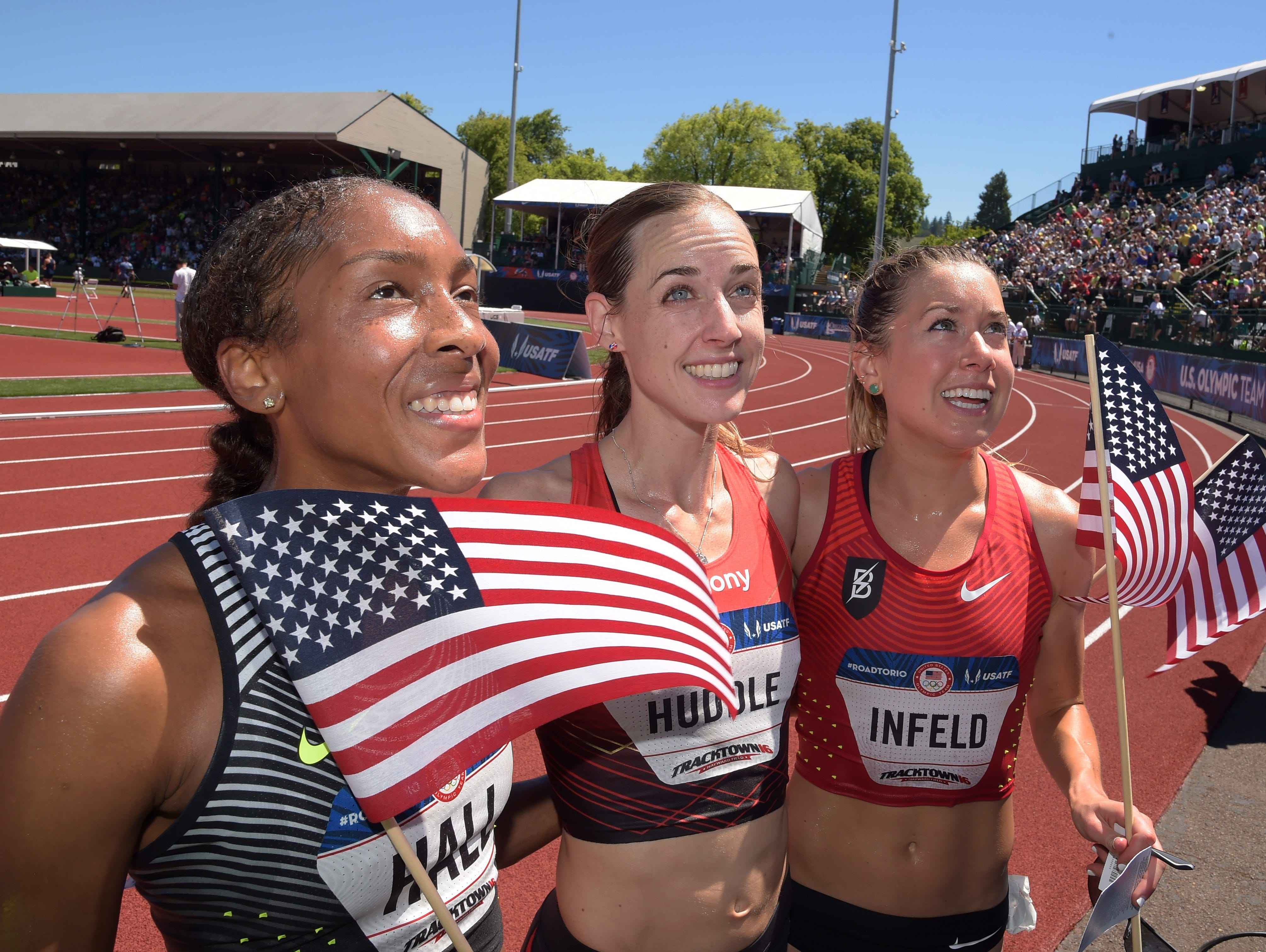 Marielle Hall (left), Molly Huddle (middle) and Emily Infeld (right) react after finishing the women's 10, 000m finals in the 2016 U.S. Olympic track and field team trials at Hayward Field.