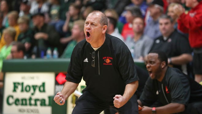 New Albany boys basketball coach Jim Shannon yells during the game against Floyd Central Dec. 9.
