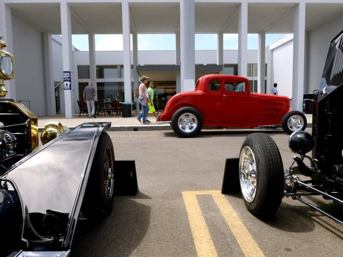 KAREN QUINCY LOBERG/THE STAR Julie Bruecker and her son Jon, 11, walk through the Fantastic Fords show at the Murphy Auto Museum on Sunday. It was the first time the Tri-County Mustang Club and the Early Ford V8 Club of Ventura put on the car show featuring Ford automobiles.
