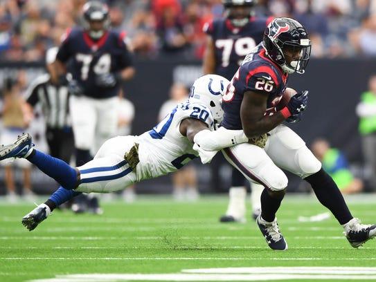 The Colts Darius Butler tackles Houston Texans running