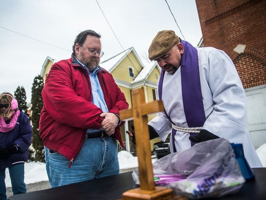 Randy Martz, of Hanover, receives ashes from Pastor