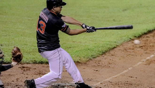 Polard Masaharu of the Orioles connects in the opening game of the Guam Major League season on May 11.