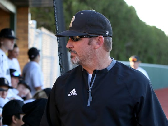 Rider head baseball coach Jeremy Crouch walks out of