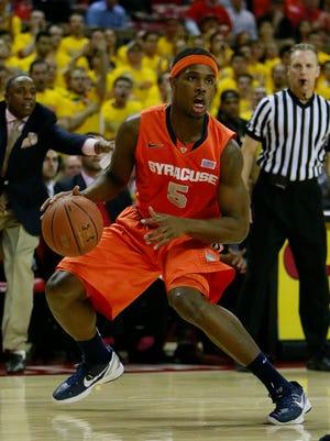 Syracuse Orange forward CJ Fair (5) dribbles the ball against the Maryland Terrapins at Comcast Center.