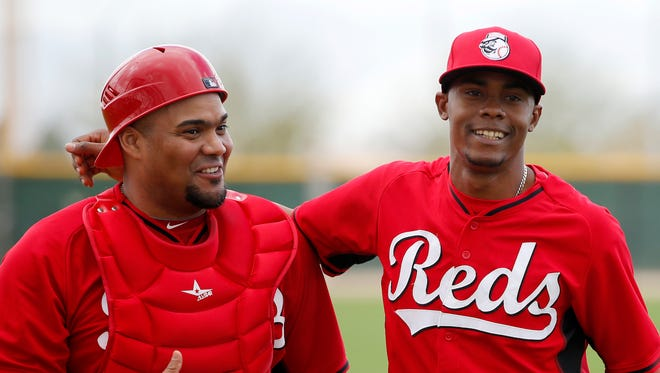 Reds catcher Brayan Pena (left) and pitcher Raisel Iglesias laugh following Iglesias' live batting practice session at spring training on Feb. 28.