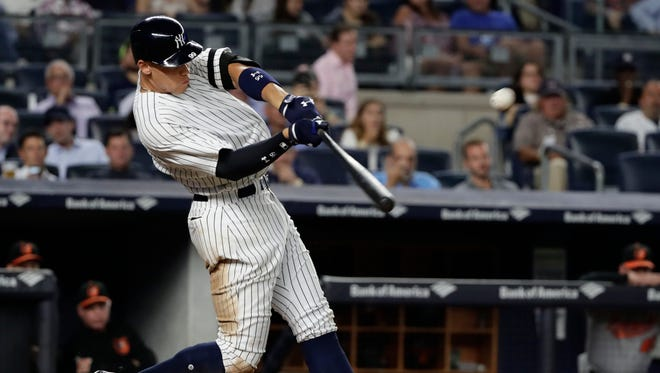 Aaron Judge hits a three-run home run during the fourth inning Thursday, July 14, against the Baltimore Orioles in New York.