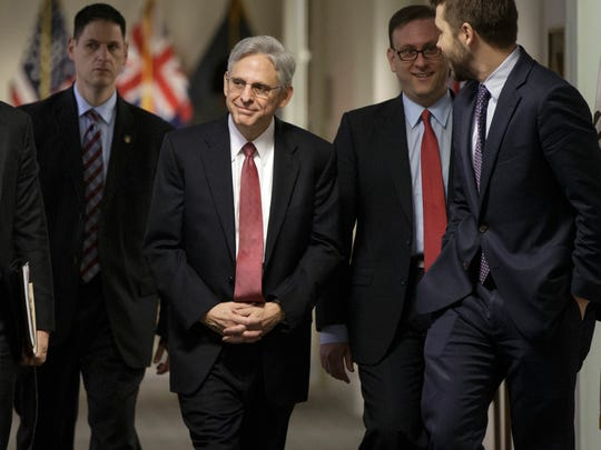 Judge Merrick Garland, President Barack Obama's choice to replace the late Justice Antonin Scalia on the Supreme Court, arrives on Capitol Hill Wednesday, March 23, 2016.