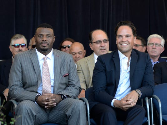 National Baseball Hall of Fame electees Ken Griffey Jr., left, and Mike Piazza smile during an awards ceremony at Doubleday Field on Saturday, July 23, 2016, in Cooperstown, N.Y. The two are to be inducted  into the Hall of Fame on Sunday. (AP Photo/Heather Ainsworth)
