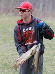 Davis Gee of Fairport holds brown trout during the 2016 John Riedman Foundation Opening Day Trout Derby at Irondequoit Creek in Powder Mills Park. The park anticipates plenty of anglers on April 1 and is reminding everyone to practice COVID-19 safety precautions.