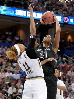 South Carolina center Alaina Coates (41) shoots over Notre Dame forward Brianna Turner (11) during an NCAA Final Four tournament semifinal game, Sunday, April 5, 2015, in Tampa, Fla.