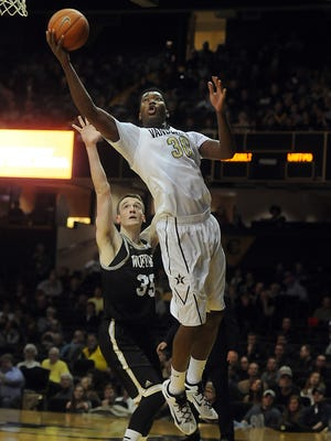Vanderbilt's Damian Jones (30) scores on a layup over Wofford's Ryan Sawvell (35) on  Dec. 19, 2015.