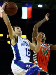 Texas A&M-Corpus Christi's Jake Kocher (12) shoots over UTRGV's Antonio Green (55) during a non-conference men's basketball game at the American Bank Center on Tuesday, Nov. 29, 2016. The Islanders will take on Texas A&M on Monday in College Station.