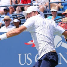 John Isner (USA) returns a shot to Jan-Lennard Struff (GER) on Armstrong Stadium on day four of the 2014 U.S. Open.