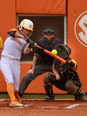 Tennessee's Meghan Gregg hits a two-run home run in the first inning against Missouri.
