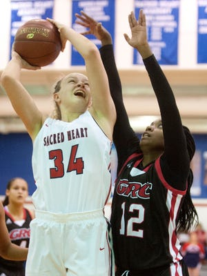 Sacred Heart guard Grace Berger puts up a shot over George Rogers Clark forward Maleaha Bell.