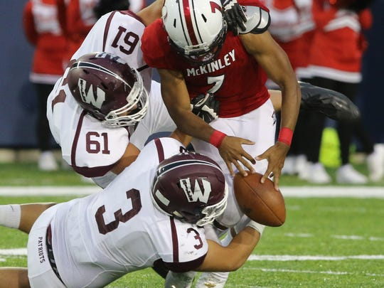 Joe Rondi and Kyle Minogue of Wayne Hills knocks the ball from  Alijah Curtis causing a fumble in the first half.
