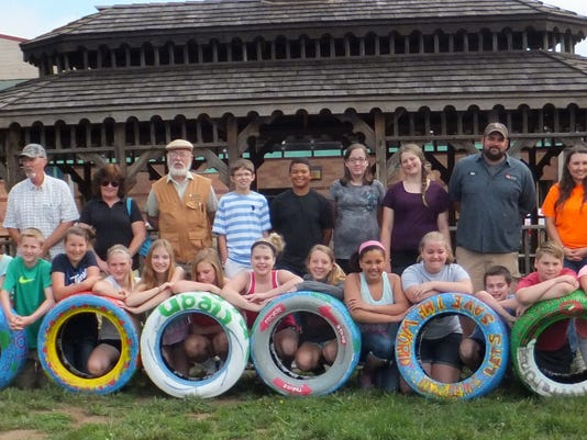 3 Tires, Students, teachers, city officials, master gardeners give the tires.JPG