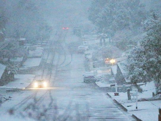 Snow falls Saturday evening along Camino Fuente Drive