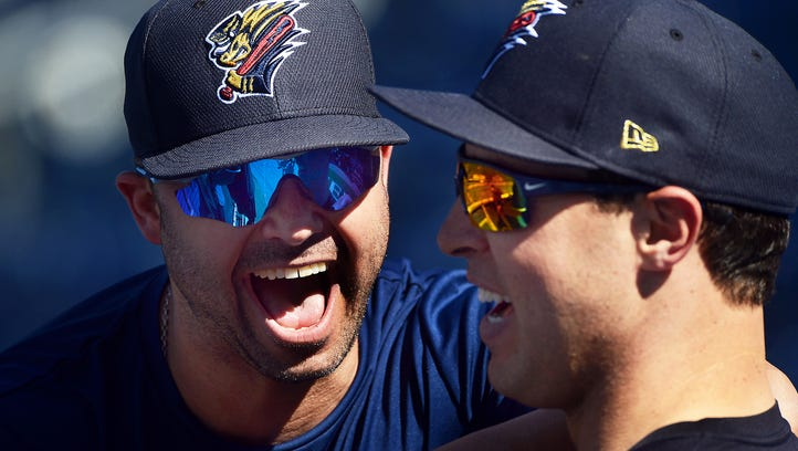 Scranton/Wilkes-Barre RailRiders' Nick Swisher, left, laughs with his former New York Yankees teammate Mark Teixeira during batting practice Tuesday, June 21, 2016, in Moosic, Pa. Teixeira is playing with the Yankees' Triple-A team on a rehab assignment.
