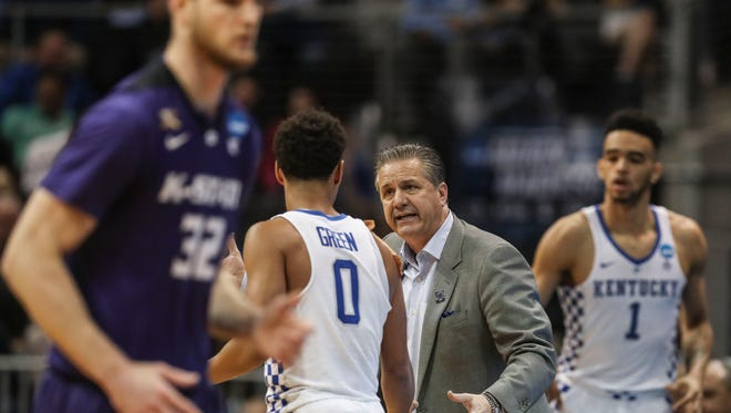 Kentucky's John Calipari talks with Quade Green during the game against Kansas State Thursday, March 22, 2018 in Atlanta's Sweet Sixteen. UK would lose 61-58.