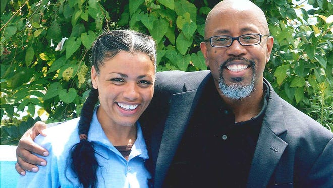 Tyra Patterson with her attorney, David Singleton, in an August 2013 photo.