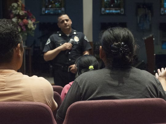 Camden County Police Capt. Gabriel Camacho speaks to undocumented immigrants during an information meeting in North Camden.