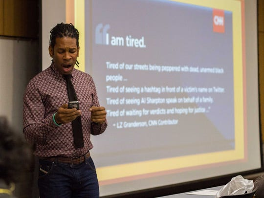"LZ Granderson reads his piece titled ""I am tired."" for his ""We are all Ferguson"" presentation at Western Michigan University on Wednesday."