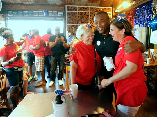 Anthony Williams (center) hugs campaign volunteers Kim Conley (right) and Joan Hurst (left) after winning the Abilene mayoral election runoff on Saturday, June 17, 2017. Williams beat Robert Briley 57.4%-42.6% in the runoff for mayor.