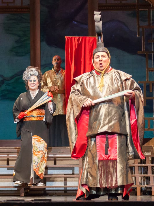 636223268599626725-Kentucky-Opera-The-Mikado-Elizabeth-Batton-as-Katisha-and-Peter-Strummer-as-The-Mikado-with-Dathan-Hooper-background-Photo-by-Bill-Brymer.jpg