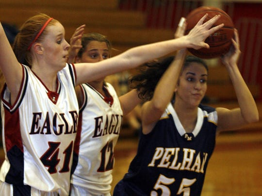 From left, Eastchester's Colleen Stewart (41) and Jaime