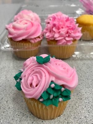 A cupcake decorating class at Candyland Crafts.