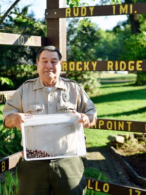 Chief Ranger Gerald Ford holds a plastic bin of upholstery tacks that were recently picked up from the Heritage Rail Trail County Park. About 200 upholstery tacks were found in a concentrated area on the rail trail in southern York County. The tacks, which can puncture bike tires and create a slow leak, also have been found on the rail trail in Maryland.