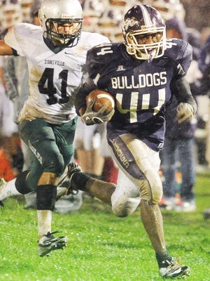 Toks Akinribade of Brownsburg had a good run but was pulled down before the endzone by Zionsville's 41 Jackson Schafer. Brownsburg hosted Zionsville in high school football Friday September 5, 2012. Rob Goebel/The Star.