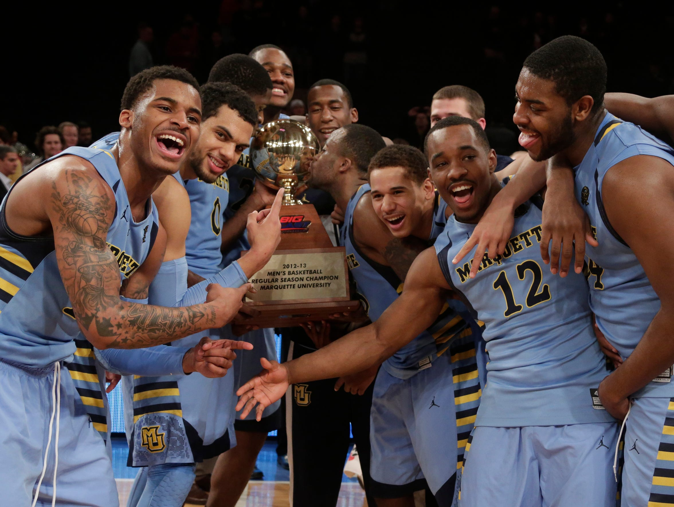 Marquette players, including guard Vander Blue (left),