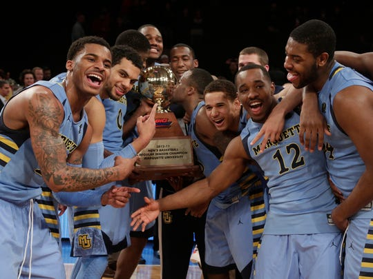 Marquette players, including guard Vander Blue (left), won the 2013 Big East title.